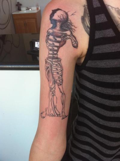 fuckyeahtattoos:  This is my third tattoo. It's a Salvador Dali drawing titled Figure With Drawers for a Four Part Screen. I love Dali's artwork and I find this image to be captivating and enigmatic. I am extremely pleased with how it turned out; the detail looks amazing.