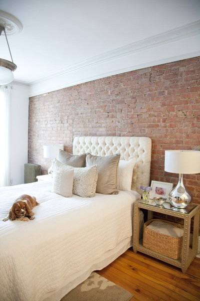 Brick wall in bedroom