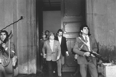 fyeah-history:  Democratically elected President Salvador Allende moments away from death during military coup at Moneda presidential palace in Chile, 1973Salvador Allende, President of Chile, died during the Chilean coup of 1973 by the Chilean Army Commander-in-Chief Augusto Pinochet. Although he reportedly committed suicide shortly after giving a radio speech to the Chilean people, there has been great controversy regarding the circumstances of his death. Allende supporters have always dismissed the military junta's version events because they believe he was assassinated.