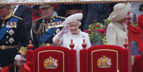 Queen Elizabeth II at the centre of her Diamond Jubilee river pageant today.