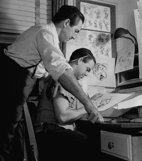 wardkimball:  #3. Ward drawing Jiminy Cricket while Walt Disney looks on, November 8, 1939.Ward was among the group of Walt Disney's most trusted animators known as the Nine Old Men. He worked for over forty years at the Walt Disney studio. Ward's creations: Jiminy Cricket in PINOCCHIO, the DUMBO crows, Lucifer, Gus and Jaq in CINDERELLA, Pecos Bill, the Cheshire Cat, Tweedledee, Tweedledum, the Mad Hatter and March Hare in ALICE IN WONDERLAND,  and, of course, Panchito Pistoles in THE THREE CABALLEROS.  This blog is going to be doing Daily Ward Kimbal updates for the next year as they prep for the book release this fall. Check it out.
