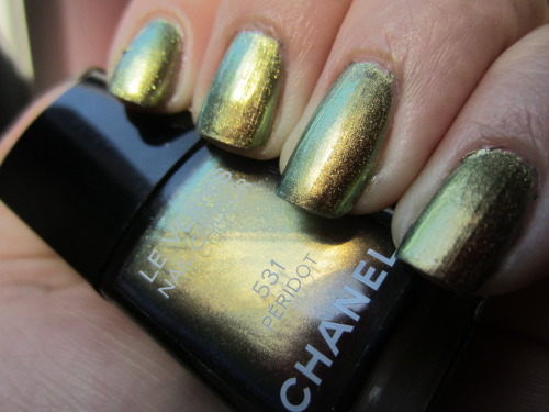 "chanel ""peridot"" after seeing all the swatches of the opi dupe for this polish, i had to bust this back out and play again.  i posted swatches of this last summer but this polish is so much fun.  if you can get your hands on a dupe you definitely should! 2 coats of a gold and green mirror on your nails.  so perfect in the summer sun"