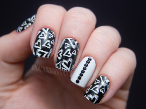 chalkboardnails:  Jamberry Nail Shields - Chalkboard HeartsWhite creme with black rhinestones I'm doing a giveaway for all of the components of this manicure! Check out the post on ChalkboardNails.com for details. Must be a follower to enter.