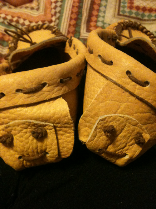 Went to a moccasin making class today! Love how they look happy!