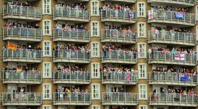 picturedept: Sunday June 2nd 2012. Spectators watch the Diamond Jubilee Pageant on the River Thames in London on Sunday. Hundreds of row boats, barges and steamers filled the river as Queen Elizabeth II sailed through the city.