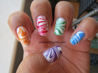 Tried out a rainbow skittle water marble! Inspired by this & this water marble! Colors used:  Wet N' Wild - French White Sally Hansen X-treme Wear - Cherry Red, Sun Kissed OPI - Funky Dunkey Essie - Mesmerized, Pretty Edgy