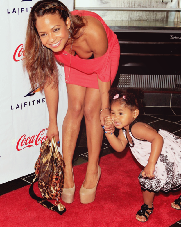 fuckyeahfamousblackgirls:  Christina Milian and her daughter Violet at the Grand Opening Celebrity VIP reception of the first Signature LA Fitness Club in Woodland Hills  (via imgTumble)