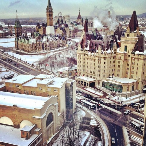 muggleotter:  canadakeepexploring:  Downtown Ottawa in the winter - by tomshap  oh i am going to miss this city in winter next year.
