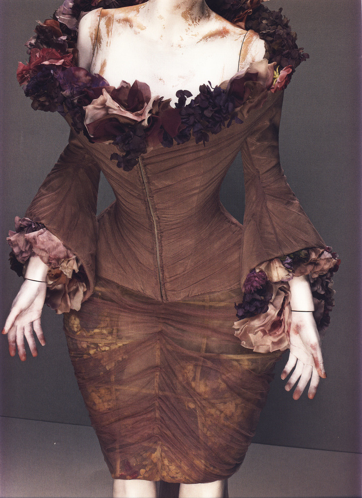 "Alexander McQueen Spring/Summer 2007 Ensemble, Sarabande Mauve silk with silk flowers and fresh flowers Photographed by Sølve Sundsbø for Alexander McQueen: Savage Beauty ""[I love the] washed out colors [in this collection]. Julia Margaret Cameron. Hand-painted Victorian pictures. So, it's not really black, it's grey. And, it's not really white, it's dirty white. And the pink is like the powder on the face."""