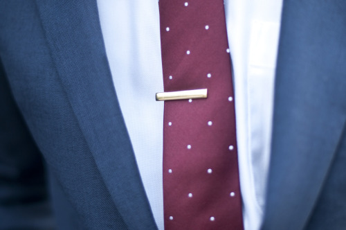 guerreisms:  The Tie Bar If you pick up a tie, the tie bar shouldn't be too far behind.  It's about keeping the tie out your food, and out your face while wearing a piece that allows you to express yourself even in settings where everyone may be dressed similarly. The details always speak volumes!