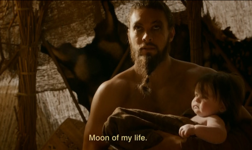 Khal Drogo, poetic warrior w/a baby in his arms. I don't need to say much else. :D