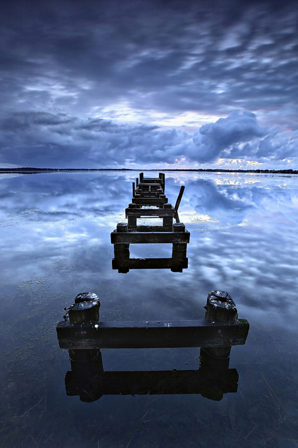 Jetty Reflections by Tim Donnelly500px.com Another capture from the other morning up at Gorokan with Tim P. It was such a still morning, wind wise, which led to some amazing reflections of one very cool sky. And even though we didn't get a lot of colour, the blue hour really did make for a…
