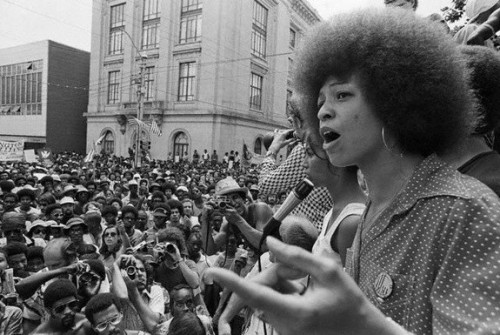 "Angela Davis (1944-) is a black feminist philosopher and political activist. During the 1980s, she was a prominent member of the Communist Party and the Black Panther Party. Davis is an outspoken abolitionist about the prison system. She should know a thing or two about prison, since in 1970, J. Edgar Hoover placed her on the FBI's Ten Most Wanted Fugitives List. This was the result of Jonathan Jackson's attack of a courtroom with weapons that were originally purchased by Davis. Davis fled. When she was eventually captured, Nixon congratulated the FBI on their ""capture of the dangerous terrorist, Angela Davis."" After spending 18 months in prison, she was acquitted of all charges. When once asked if she approved of violence, Davis responded by describing the bombings of black houses and churches that occurred as she was growing up in Birmingham, Alabama, saying:  That's why when someone asks me about violence, I just find it incredible. Because what it means is that the person who's asking that question has absolutely no idea what black people have gone through. What black people have experienced in this country since the time that the first black person was kidnapped from the shores of Africa.  Sources: Wikipedia, The Black Power Mixtape (video)"