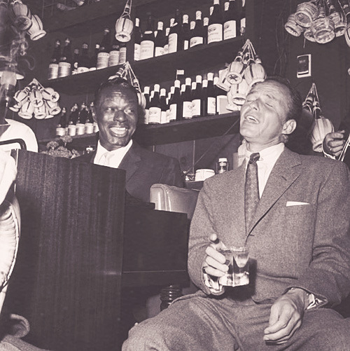 theniftyfifties:  Nat King Cole and Frank Sinatra at Villa Capri, 1955.  genius