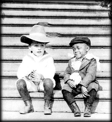 "legrandcirque:  Quentin Roosevelt, son of US 26th President, Theodore Roosevelt, and one of his ""White House Gang"" playmates, Rosewell Flower Pinckney, in 1902. The White House Gang was made up of the young companions of the Roosevelt children who wrecked havoc on White House decorem, shooting spit balls at a portrait of Andrew Jacksonand wearing fake monocles, among other childhood pranks. Source: White House Historical Association"