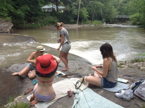girls on a creek in woodstock.