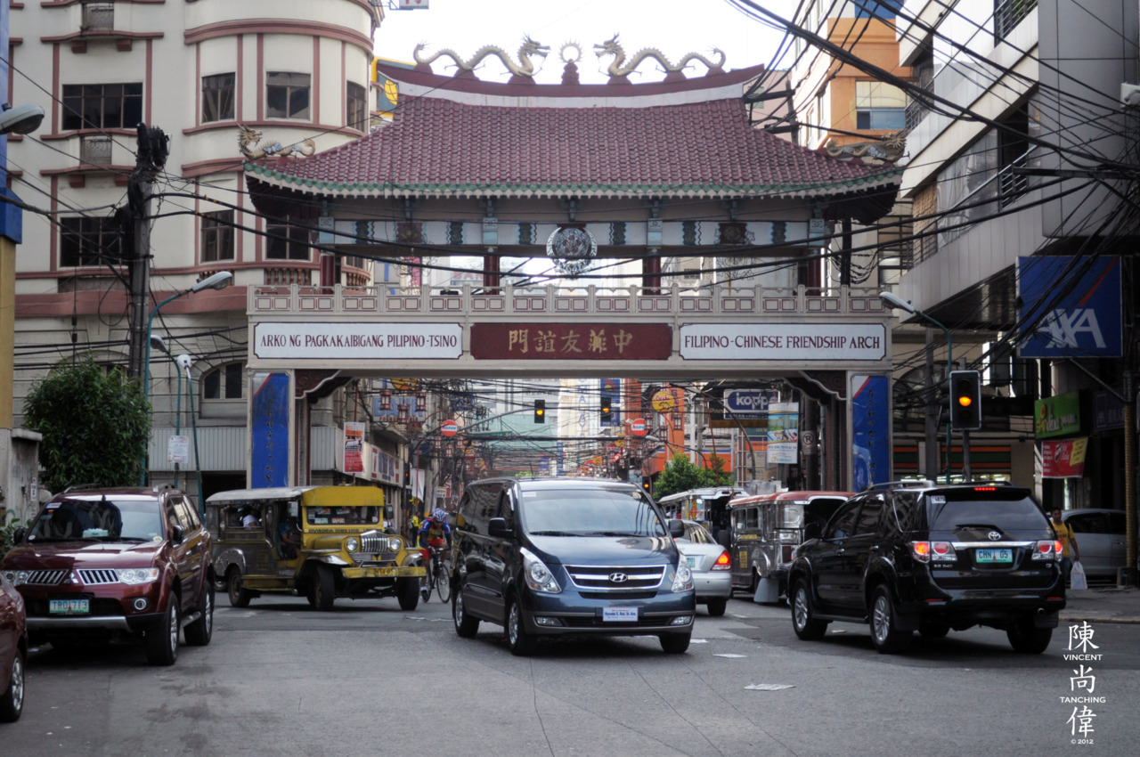 """FORWARD THROUGH BINONDO'S GATE"" Another buwis buhay shot, standing in the middle of Binondo's primary thoroughfare, Quintin Paredes street. This photo is special to me because, having Chinese roots, it reminds the special bond between this part of the city and a part of my humanity. :)  Shot using a NIKON D5000AF-S DX NIKKOR 18-55mm F/3.5-5.6 VR42mm F/5.6ISO 400EXPOSURE TIME 1/640"