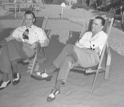 John Edgar Hoover and his assistant Clyde Tolson sitting in beach lounge chairs, c. 1939John Edgar Hoover (January 1, 1895 – May 2, 1972) was the first Director of the Federal Bureau of Investigation (FBI) of the United States. Appointed director of the Bureau of Investigation—predecessor to the FBI—in 1924, he was instrumental in founding the FBI in 1935, where he remained director until his death in 1972 aged 77. Since the 1940s, rumors have circulated that Hoover was gay. There are speculations that Clyde Tolson, an associate director of the FBI and Hoover's primary heir, may have been his lover.