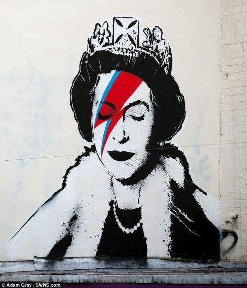 Banksy is believed to have made his own tribute to the Queen's Diamond Jubilee celebrations by stenciling a picture of Her Majesty as Aladdin Sane. The graffiti artist-cum-mainstream pop culture icon is apparently behind the work, which shows the crown-wearing monarch sporting a jagged red stripe, just like the Seventies David Bowie creation. The startling image of Elizabeth II - which sprang up as the country celebrated her 60 years on the throne - appeared on a wall previously used by the street artist. The image of the Queen with her eyes shut mirrors that of Bowie's original Aladdin Sane album cover, with the main difference being the substitution of the original orange and blue face paint for a more patriotic red and blue. Although the work is in his unique style, the homage to Her Majesty is out of character for Banksy, whose works usually carry a sharp anti-authoritarian political message. He has not yet claimed responsibility for the artwork on his website, where images of his graffiti are usually displayed.Read more: http://www.dailymail.co.uk/news/article-2154364/Banksy-creates-unique-Jubilee-tribute-Queen-David-Bowies-Aladdin-Sane.html#ixzz1wppzsa2g