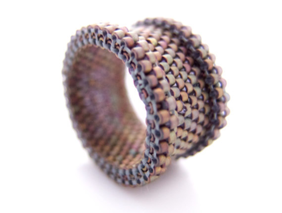 Makes a great gift father's day gift!(via Copper Ring Band Brown Beaded Ring Couple Ring by JeannieRichard)