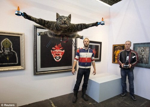 Dutch artist Bart Jansen turned his dead cat into a helicopter. That's all for today. Photo via Reuters