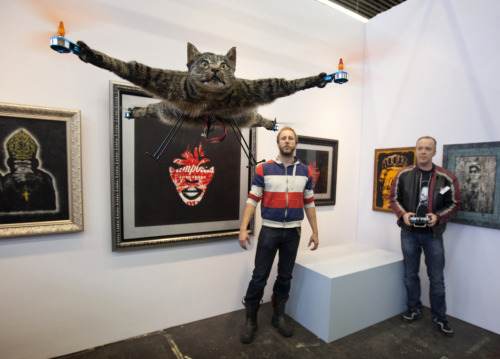 "reuters:  The Orvillecopter by Dutch artist Bart Jansen (back L) flies in a gallery as part of the KunstRAI art festival in Amsterdam June 3, 2012. Jansen said the Orvillecopter is part of a visual art project which pays tribute to his cat Orville, by making it fly after it was killed by a car. He built the Orvillecopter together with radio control helicopter flyer Arjen Beltman. [REUTERS/Cris Toala Olivares] FULL FOCUS: The best photos from the past 24 hours  Ranks just above ""cat shrine"" on the ""most disturbing ways to honor your deceased cat"" list."