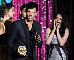 Taylor Lautner, Kristen Stewart and Nikki Reed on stage while accepting the Movie Of The Year award for 'Twilight Saga: Breaking Dawn - Part 1' at the 2012 MTV Movie Awards in Los Angeles