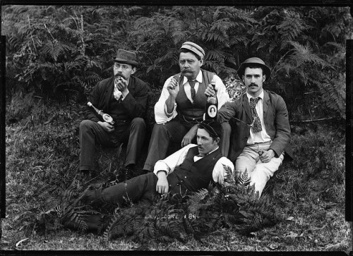 Four well-dressed men holding beer bottles by Powerhouse Museum Collection on Flickr.