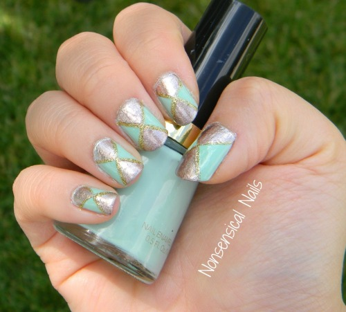 "Mint green and gold is officially one of the most fabulous combinations ever. This look is super easy and fun to do, but there are a few tips to follow for success. I began by applying three coats of Revlon's ""Mint"". I let this dry for a few hours so that I was sure it was completely dry. Next, I used two pieces of scotch tape, with the corners meeting in the middle of my nail. Something really important is that you want to cut the ridged edge off of the tape from where you tore it off so that it's completely smooth. I then painted one coat of Orly ""Rage"" on the two exposed triangles of my nail. I advise you to work one nail at a time, that way you can peel the tape off immediately, that way it won't dry and it will come off smooth. Lastly, I used my LA Color Club nail art polish in ""Gold"" to outline the triangles. This is optional, but I think it gives it a more finished look, as well as hiding any tiny imperfections from where you tore the tape off! Finish with a topcoat, and voila!"