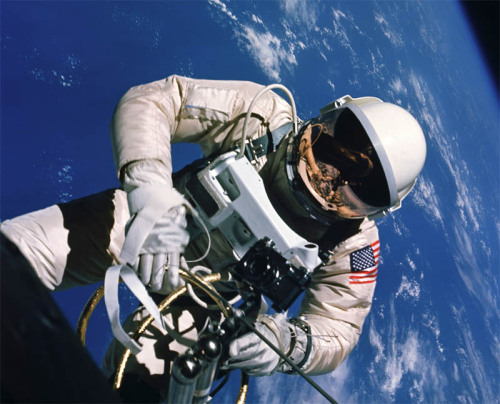 "Stepping Out in Space — NASA's First EVA On the afternoon of June 3, 1965, Ed White stood up on his seat and stuck his head out of Gemini 4's open hatch into space. He was in orbit with commander Jim McDivitt, and both were men waiting for a ""go"" from Houston to begin America's first spacewalk. White knew he would be facing some difficulties on the spacewalk, properly called ""extravehicular activity,"" or EVA. He'd already mounted a video camera on the spacecraft's body just above the hatch, and it was more work than he'd anticipated. The ordinarily simple task demanded enough physical exertion that he worked up a sweat and starting breathing pretty heavily. Listening on the communications line, McDivitt warned White to take it easy. It was the first time during the mission that White's heart rate sped up enough to catch the attention of flight surgeons in mission control. keep reading"