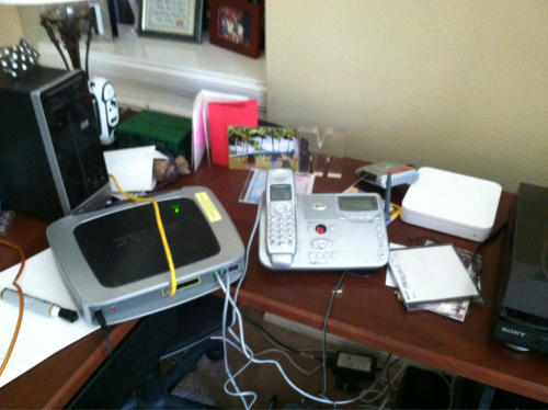LOOK AT THIS MESS MY DESK HAS BECOME  I MISS MY APPLE AIRPORT  I MISS MY CLEAN DESK  AND THAT ROUTER IS CREEPY  AND THE BATTERY BEEPS CREEPILY  I HATE YOU, AT&T UVERSE