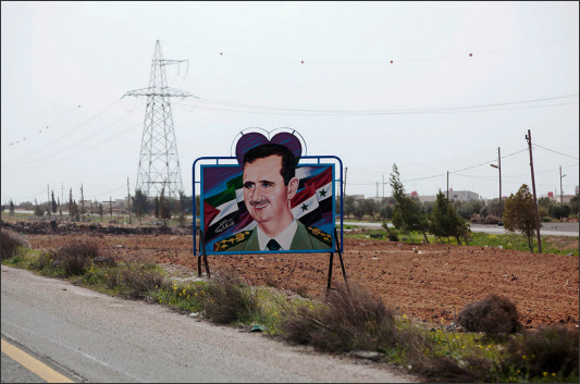 Bag's Take-Away:  Assad as Mickey Mouse. What could be more ironic? From Oliver Hartung's Signs of Syria (NYT).  via The New York Times (credit: Oliver Hartung caption:  Between Damascus and As Suwayda. 2009.) Visit BagNewsNotes: Today's Media Images Analyzed ————— Topping LIFE.com's 2011 Best Photo Blogs — also follow us on Twitter and Facebook.