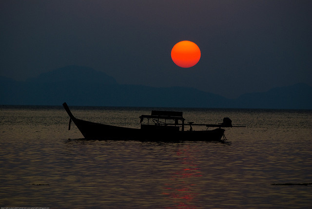 Longtail boat at sunset at Ting Rai Bay, Koh Jum, Thailand by Adam Cathro on Flickr.
