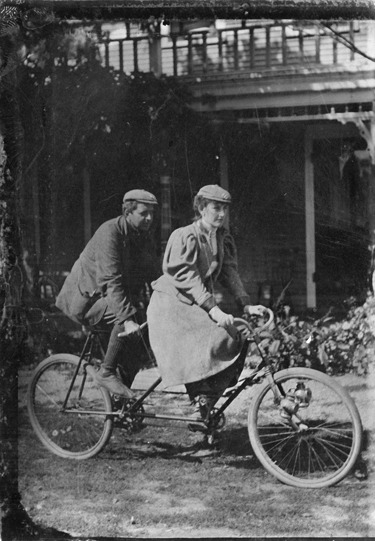 Mae Sawyer Stibgen rides a tandem bicycle with an unidentified man on an outing with the Lincoln Cycling Camera Club in Half Day, Illinois, c. September 20, 1896. Photographer unknown.  Want a copy of this photo?  > Visit our Rights and Reproductions Department and give them this number: ICHi-20570. Connect with the Museum