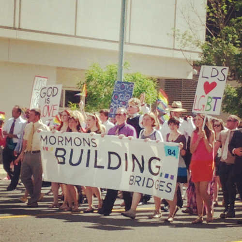 "singingwithcagedbirds:  In the Salt Lake City pride parade, over 300 Mormons started the parade.  They marched behind a banner that read, ""Mormons building bridges.""  They were dressed in their sunday best. Megan cried through the whole thing. When we looked around us there were no dry eyes. Everyone seemed to be wiping tears away. In an article after the parade, a woman in the group said, ""As we marched, I was taken back by how many people were emotional. It made me realize how much damage we have caused this community and how much more we need to do to repair it."" It was beautiful."