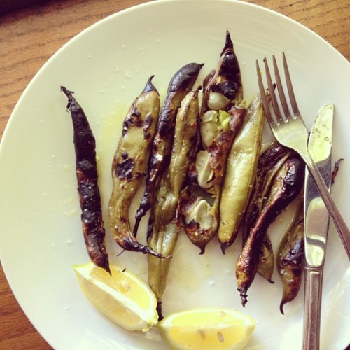 Broiled fava beans, via @LocalLemons. Never peeling these suckers again. Just broil with olive oil, salt and pepper. Top with minced garlic and a squeeze of lemon. Amazing. #lunch #meatlessmonday (Taken with instagram)