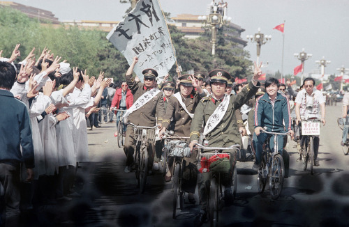 Beijing police parade through Tiananmen Square carrying banners in support of striking University students, on May 19, 1989. The students were in the sixth day of their hunger strike for political reform. (AP Photo/Sadayuki Mikami)