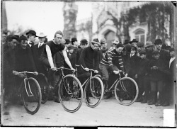 J. A. Spenks, C. G. Starsch, Dick Strutz, and an unidentified cyclist position their bicycles on North Michigan Avenue in front of the Water Tower for the start of a race, c. 1901. Photograph from the Chicago Daily News.  Want a copy of this photo?  > Visit our Rights and Reproductions Department and give them this number: SDN-000522. Connect with the Museum