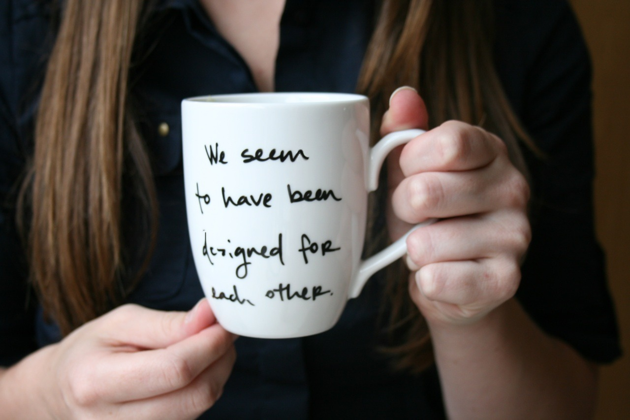 "Look at my snazzy mug! ""We seem to have been designed for each other."""