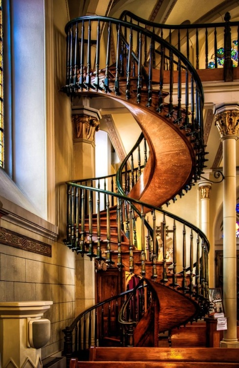 "samaralex:  The Miraculous Staircase by Len Saltiel // Loretto Chapel, Santa Fe ""Completed in 1878, there was no way to access the choir loft twenty-two feet above. Carpenters were called in to address the challenge but the only solution seemed to be a ladder given the small size of the chapel. The Sisters of the Chapel prayed to St. Joseph, the patron saint of carpenters. As legend would have it, a man appeared at the Chapel with a donkey and a toolbox looking for work. He built this staircase which has two 360 degree turns and no visible means of support. Once completed, the carpenter disappeared without pay or thanks and many concluded that he was St. Joseph himself, having come in answer to the sisters' prayers. Even today, experts are perplexed and amazed at its construction and design. Whether you believe the legend or not, it is an amazing staircase."""
