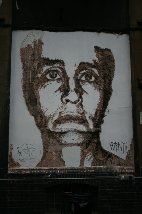 street art by Alexandre Farto, better known as Vhils, in Brick Lane, London