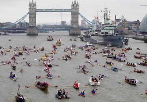 The River Thames became a royal highway Sunday, as Queen Elizabeth II led a motley but majestic flotilla of more than 1,000 vessels in a waterborne pageant to mark her Diamond Jubilee.  In a colorful salute to the island nation's maritime past, an armada of skiffs and sailboats, rowboats and paddle steamers joined a flower-festooned royal barge down a 7-mile (11-kilometer) stretch of London's river.  (click-through for full story)