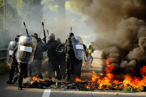 thepoliticalnotebook:  Picture of the Day: Vega Del Rey, Spain. Riot police near a burning barricade during a miners strike. Credit: Juan Manuel Serrano Arce/AP. Via. View more Picture of the Day posts. Submit a photo.