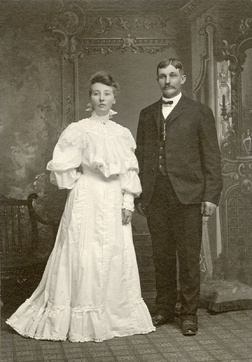 Studio wedding portrait of Frankish and Alice Tyndall, Waterford, Wisconsin, 1904. Frankish Tyndall, age 45, married 21-year-old Alice Barnes on Christmas Day, 1904. Alice's high-necked wedding gown with long layered sleeves is typical of the Edwardian era. A similar dress, along with coordinating fan, shoes, parasol and crinoline, can be viewed online in the Metropolitan Museum of Art's Costume Institute. via: Waterford Public Library by way of University of Wisconsin Digital Collections