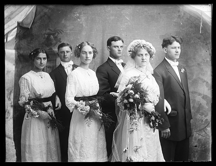 Wedding party in Adams County, Wisconsin, 1910-1930. This unidentified bride and groom, plus their four attendants, posed for professional photographers Leon and Eugene Taylor in Adams County, Wisconsin sometime in the early 20th century. via: Taylor Brothers Photographs, Murphy Library, University of Wisconsin-La Crosse by way of University of Wisconsin Digital Collections
