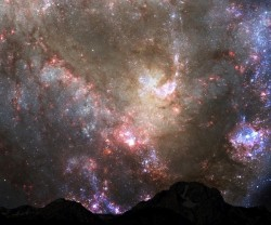 "Source: NASAThe night sky in 3.9bn years as Andromeda collides with the Milky Way.""Dust from a distant sun / Will shower over everyone"""