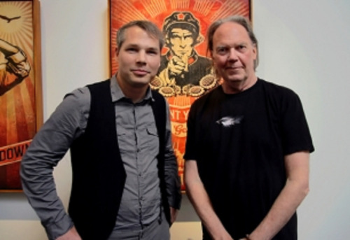 Also, Americana is out today.  foreverneilyoung:  Artist Shepard Fairey and Neil Young Photo by Claire Marie Vogel Click on the link to read more about their collaboration for the new album Americana