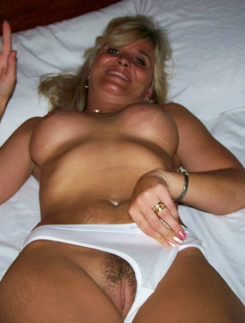 repostedslutwives:  Nice pube trim… Wedding ring… What's not to love?