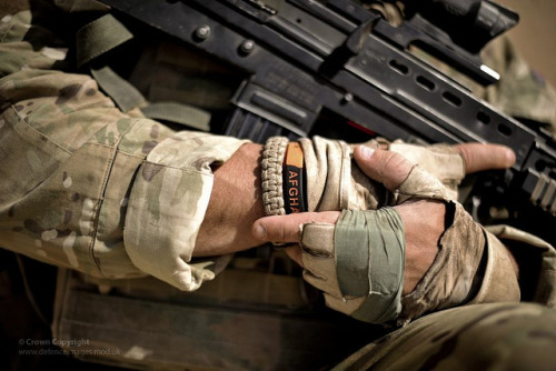 Soldier Holding Rifle on Operations in Afghanistan by Defence Images on Flickr.