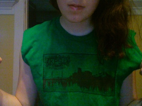 wearing this kpsu shirt i cut into a muscle tee